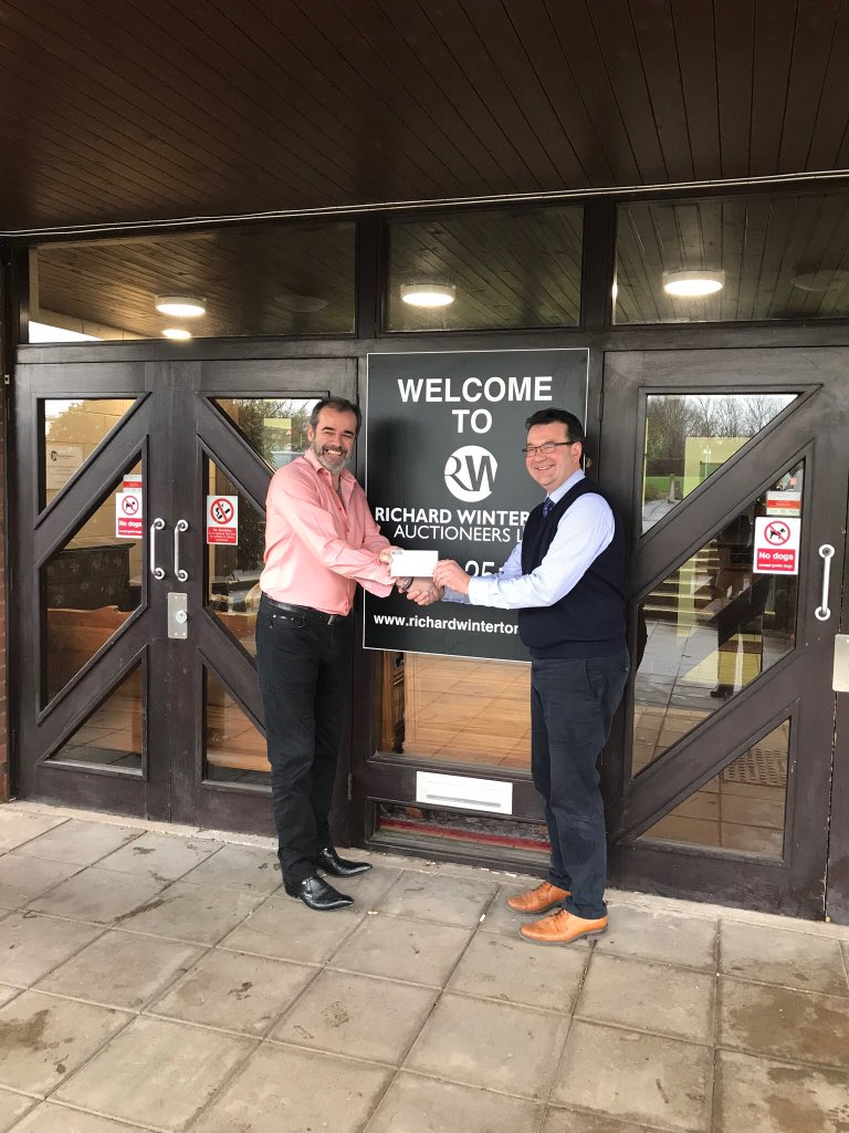 Richard Winterton hands over £1,000 to We Love Lichfield