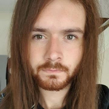 Liam loses long locks in charity hair cut