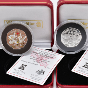Lot 159, a boxed pair of Christmas 50p silver proofs showing six geese a-laying, sold for £800.