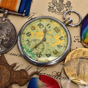 Lot 197 The medals archive of Dr George Hall-Davis including a Jaegre-LeCoultre pocket watch with the British military crow's foot marking.