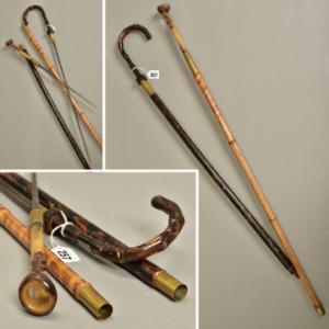 Lot 257: Two antique sword sticks.