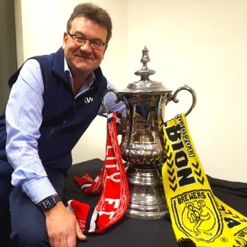 Auctioneer Richard Winterton with a Portmeirion ceramic replica of the FA Cup.