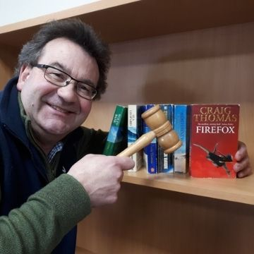 Richard Winterton with a selection of Craig Thomas' books. Copyright to the Firefox author's 18 novels sold for £36,000 at auction online from Lichfield.