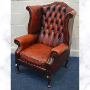 This oxblood leather armchair sold at auction for £210.