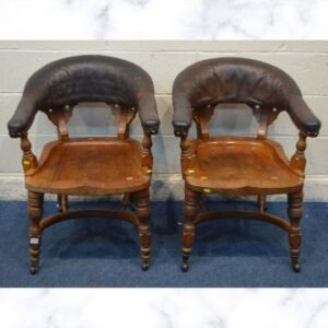 This pair of 19th century walnut club chairs went under the hammer for £800.