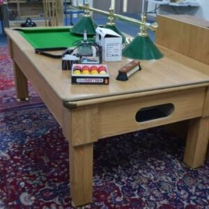 This ingenious pool/dining table sold at auction for £280.
