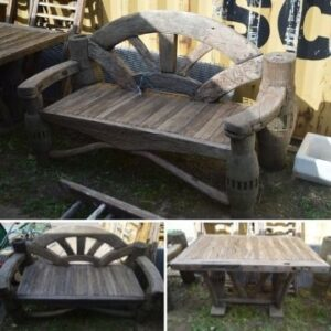 Lot 1160, a three piece wooden garden set. The upright supports are made out of Vietnamese ox cart axles, with the bench backs in the form a cart's wagon wheel.