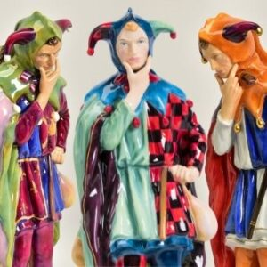 Three 44cm tall Royal Doulton Prestige models of Jack Point, Charles Noke's classic jester figure.