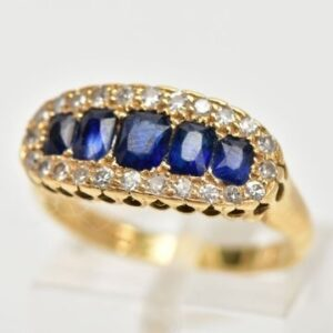 Lot 34: An 18ct gold sapphire and diamond half hoop ring.