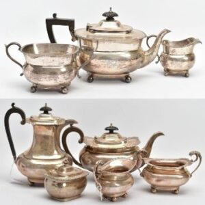 An early C20th three-piece silver tea set (top) and a silver five-piece tea set to include teapot and hot water jug, each with a wooden scroll handle. Lot 73 (top) and Lot 83.