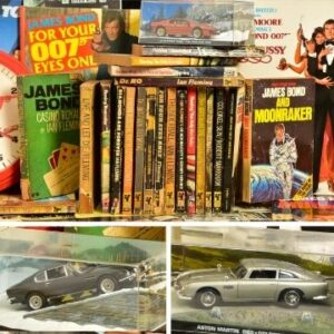 Lot 548 features a comprehensive collection of Pan paperbacks of Ian Fleming's Bond books and Lot 513 is an almost complete set of the GE Fabri James Bond Car Collection models.