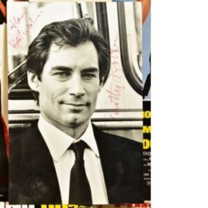 Lot 548 includes a signed photograph of Timothy Dalton, Roger Moore's successor as James Bond.