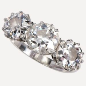 Lot 2: A large three stone diamond ring.